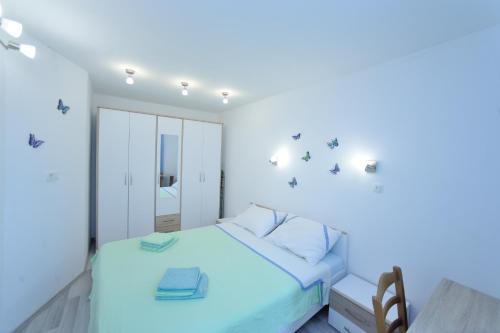 Voodi või voodid majutusasutuse Apartman Svilno toas
