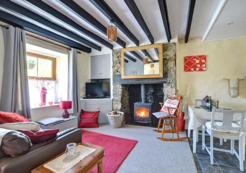 A seating area at Mynydd Annedd Cottage