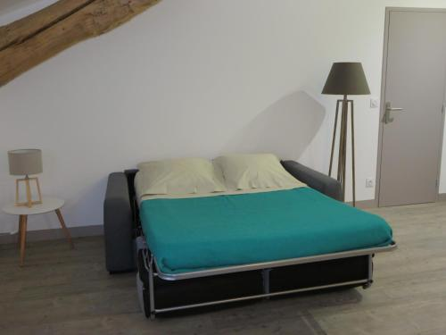 Un ou plusieurs lits dans un hébergement de l'établissement Gîtes Lieu Dit Cruzel