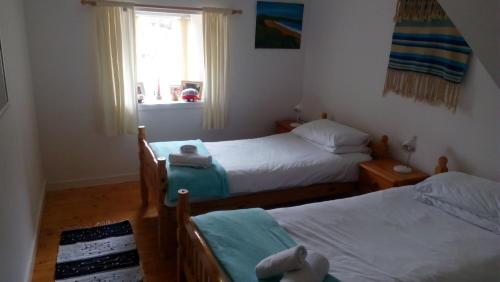 Vuode tai vuoteita majoituspaikassa Seaside Holiday Cottage Embo