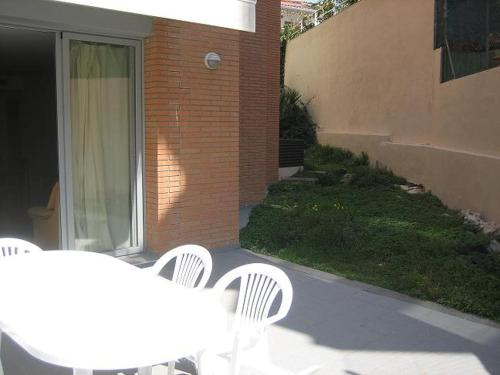 A porch or other outdoor area at Apartments Nausica Beach