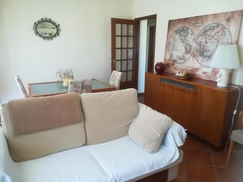 A bed or beds in a room at Vila Cha Apartment