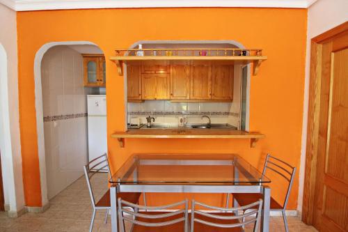 A kitchen or kitchenette at Veramar 2 Bajo
