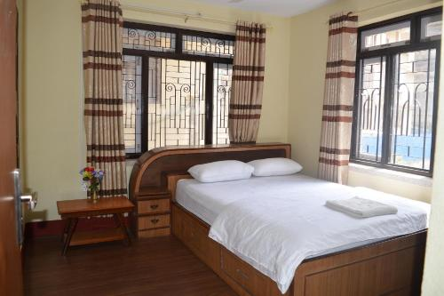 A bed or beds in a room at Apartment in Nepal