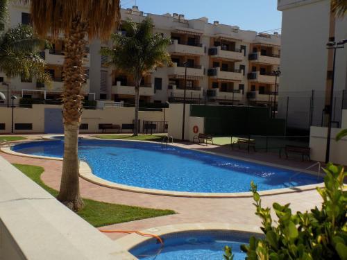 The swimming pool at or near Apartamento Playa de Almenara