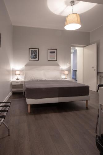 A bed or beds in a room at maribea rome center