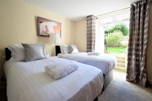 Ein Bett oder Betten in einem Zimmer der Unterkunft Greystone Avenue - yourapartment