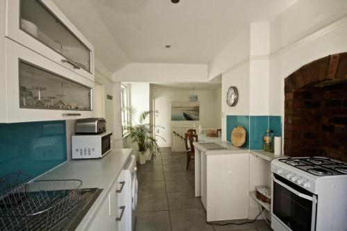 A kitchen or kitchenette at River Exe Apartment