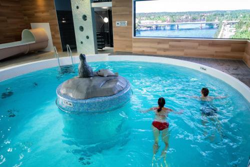 The swimming pool at or near Imatran Kylpylä Spa Apartments
