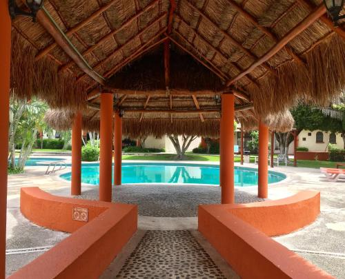 The swimming pool at or near Lovely Condo in Cancún 3bd/2ba near Beach & Mall.