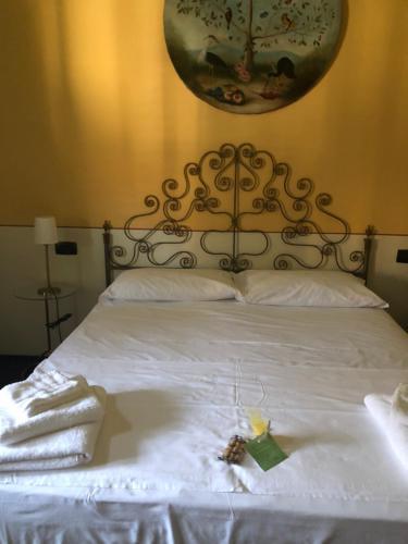 Letto o letti in una camera di Relais Carolina