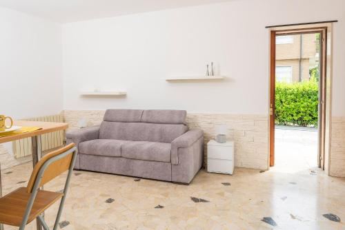 Area soggiorno di Villa Mattarana - Moderno Appartamento Piano Terra