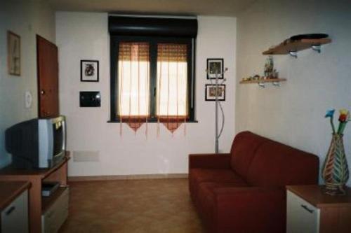 A seating area at Luminoso E Grazioso Appartamento Bosa