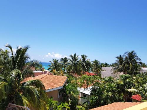A view of the pool at Casa Amarilla Playacar 1 or nearby