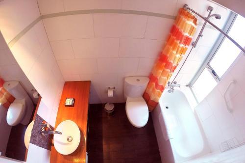 A bathroom at Austral Suites