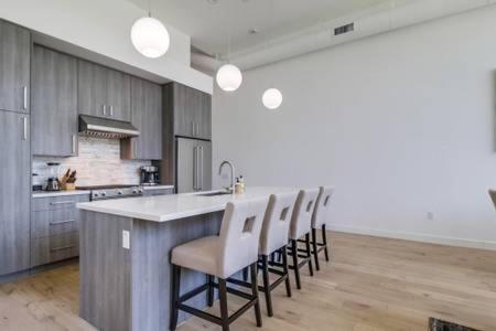 A kitchen or kitchenette at Spacious San Diego Loft + Parking