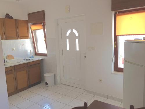 A kitchen or kitchenette at Apartments Vesna