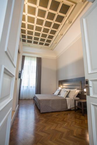 Un ou plusieurs lits dans un hébergement de l'établissement Re Vittorio De Luxe