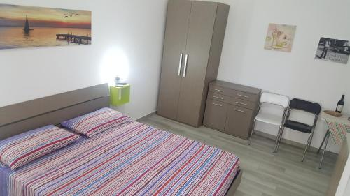 A bed or beds in a room at Casa Vacanza Carmine