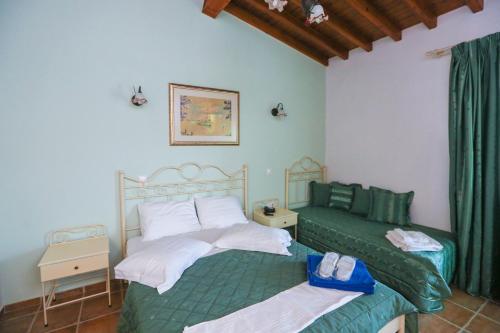 Postelja oz. postelje v sobi nastanitve Skiathos Island Suites
