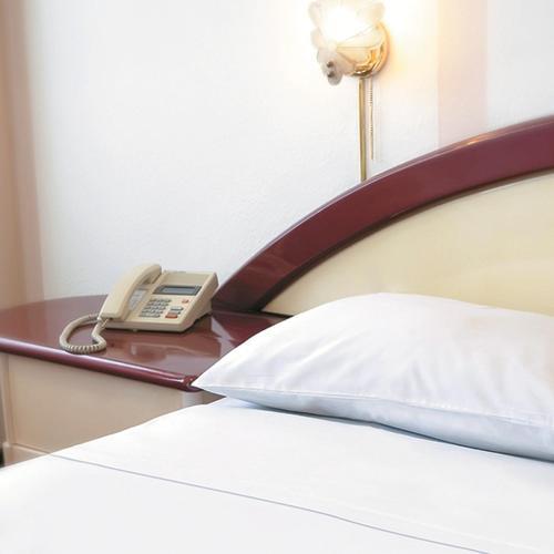 Cama o camas de una habitación en Americana Hotel