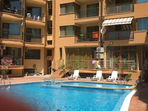 The swimming pool at or near Modern 1 bedroom apartment in Amadeus 5