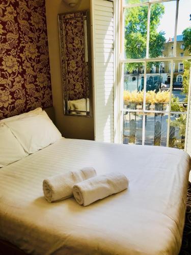 Vuode tai vuoteita majoituspaikassa Excelsior Hotel