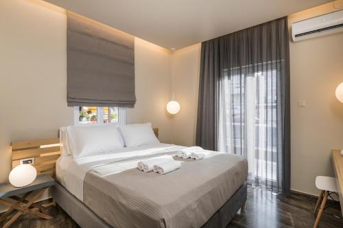 A bed or beds in a room at Sun Ray Luxury Apartments (Adults Only)