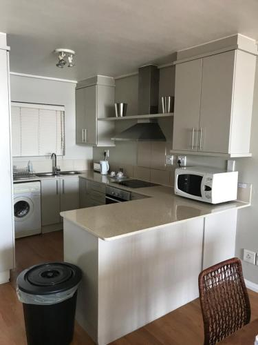 A kitchen or kitchenette at Lagoon Beach Apartment & Spa
