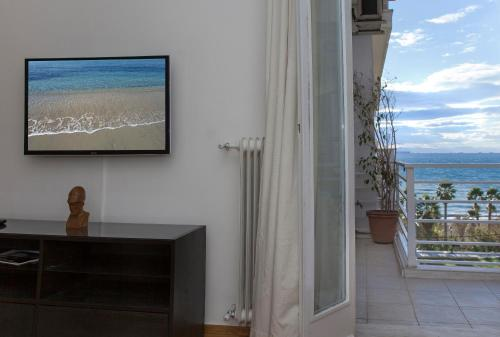 A television and/or entertainment center at 4th Floor Remodeled condo with Sea and Beachfront Views