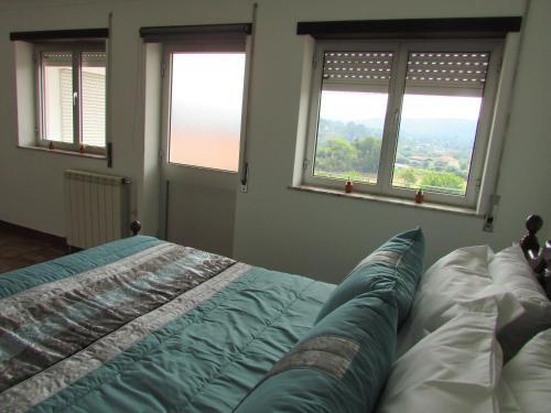 A bed or beds in a room at Casa da Tia Rosa