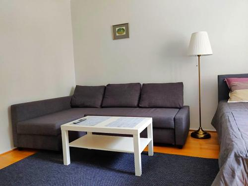 A seating area at Spacious apartment DIANA in Helsinki city center