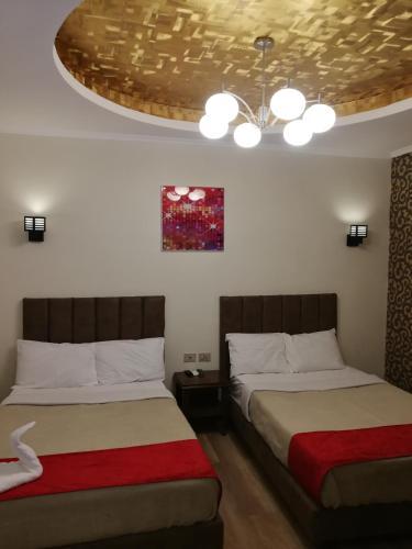 Een bed of bedden in een kamer bij Cordoba Suits