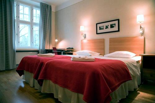 Ein Bett oder Betten in einem Zimmer der Unterkunft Hellsten Helsinki Parliament
