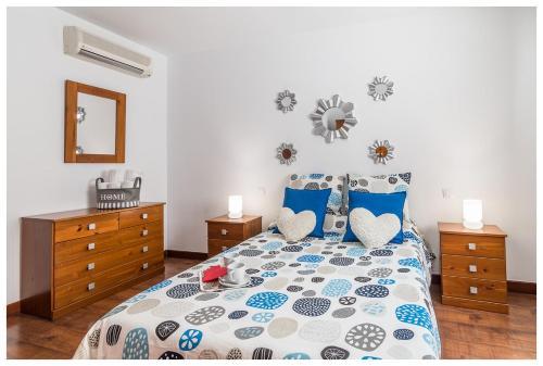 A bed or beds in a room at La Casita del Centro