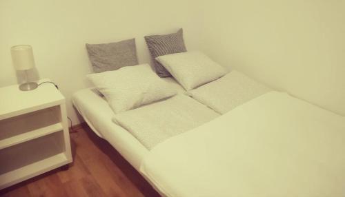 Ein Bett oder Betten in einem Zimmer der Unterkunft Apartment Wasagasse