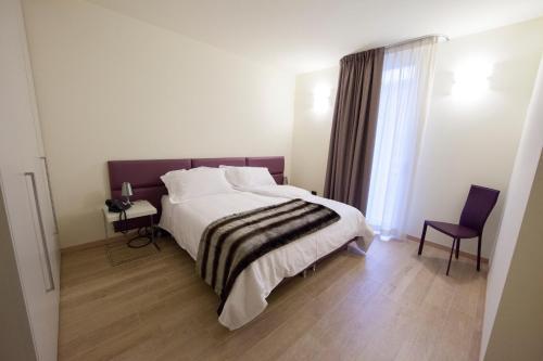 Säng eller sängar i ett rum på Residenza Agnello D'Oro