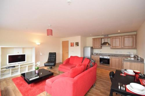 A kitchen or kitchenette at The Plaza Apartments (Great Location + Free Car Parking Near Glasgow City Centre)