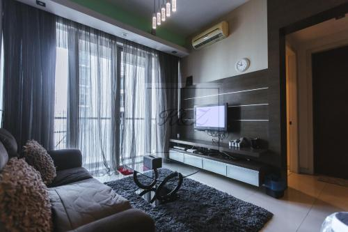 A television and/or entertainment center at Marc Residence @ KLCC with Pool View Balcony