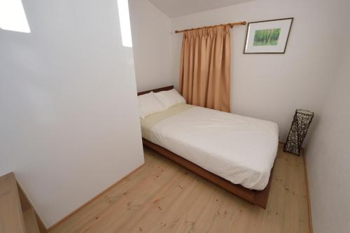 A bed or beds in a room at Kyoto - house / Vacation STAY 1099