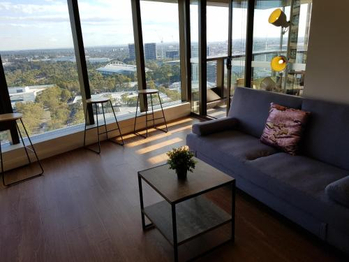 A seating area at Skygarden olympic park view 2 bedroom apartment