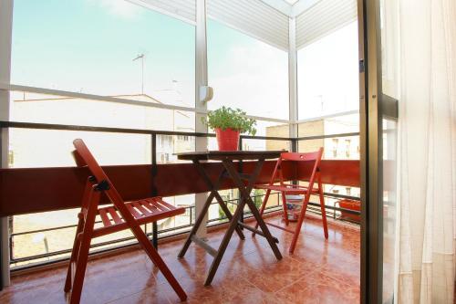 A balcony or terrace at Beautiful family apartment in Sevilla