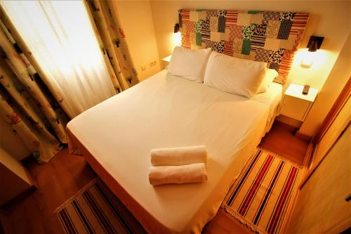 A bed or beds in a room at CasaDe Mercedes