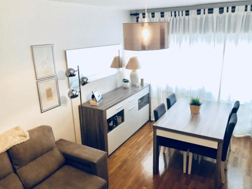 A kitchen or kitchenette at WHome | Gaia Deluxe Apartment