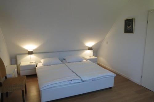 Кровать или кровати в номере Wetterkantwoning