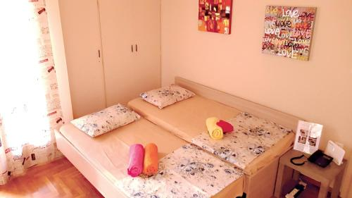 Ліжко або ліжка в номері Best VFM in Athens
