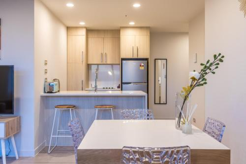A kitchen or kitchenette at Star Victoria Serviced Apartments
