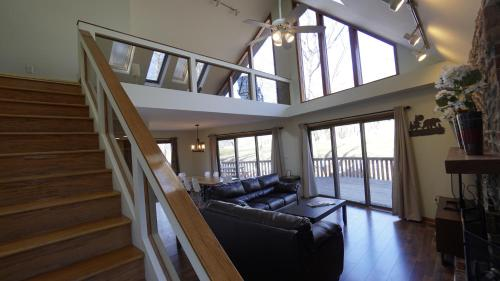 A seating area at Pocono Mountains Chalet home at Lake Wallenpaupack-Pool Table-Fire Pit-Golf course views