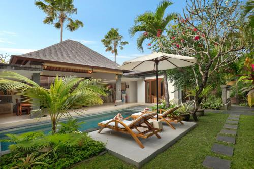 The swimming pool at or near The Buah Bali Villas