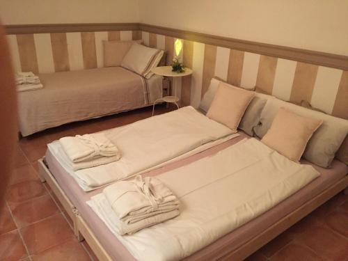 A bed or beds in a room at Il Prunaio
